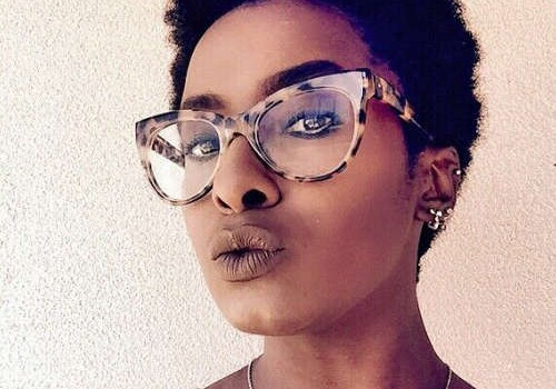 Are these the right frames for you? Woman wearing glasses.