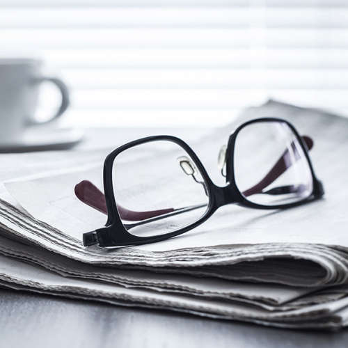 Glasses on newspaper.