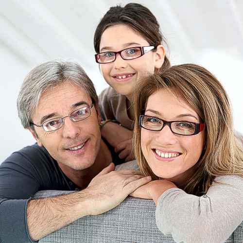 Our promise to you and your family. Mother, father and daughter all wearing glasses.